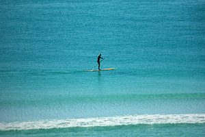 Paddle boarding behind the Adagio condos on the Gulf of Mexico in NW FL